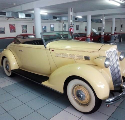 P0057 alquiler Packard V8 1937 vehiculos escena epoca peliculas tyreaction