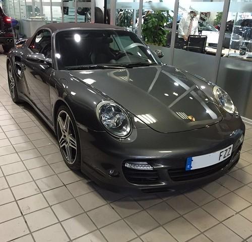 P0036 Porsche 911 (997) cabrio gris fosc int marrón