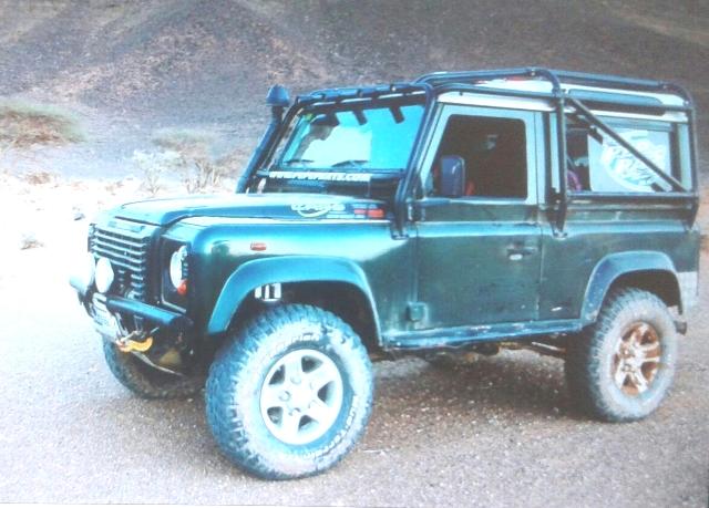 00002 Land Rover defender corto verde front