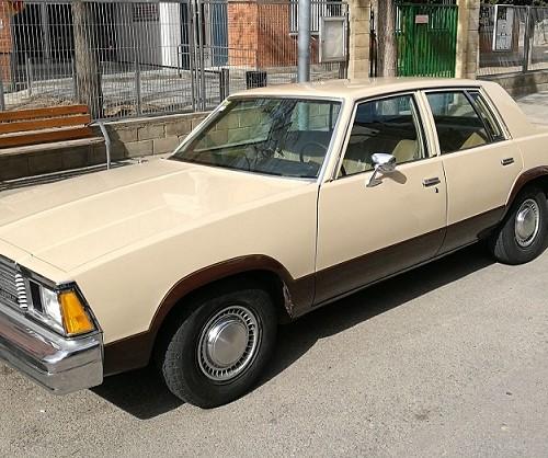 P0001 Alquiler Chevrolet malibu crema marron