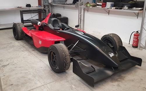 p0161 alquiler formula 1 3000 competicion carreras negro rojo front tyreaction vehículos de escena picture vehicles spain