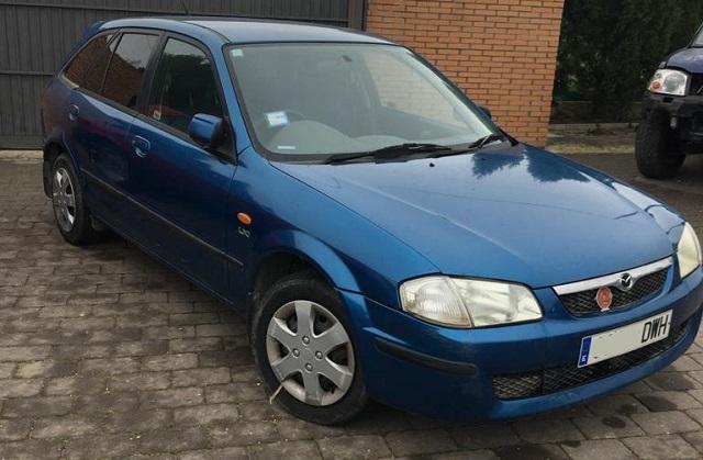 pm014 alquiler mazda 323 azul vehículos de escena madrid tyreaction front