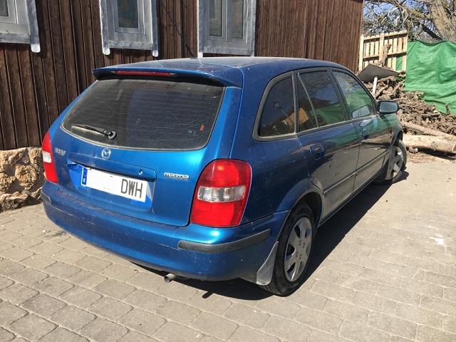 pm014 alquiler mazda 323 azul vehículos de escena madrid tyreaction tras